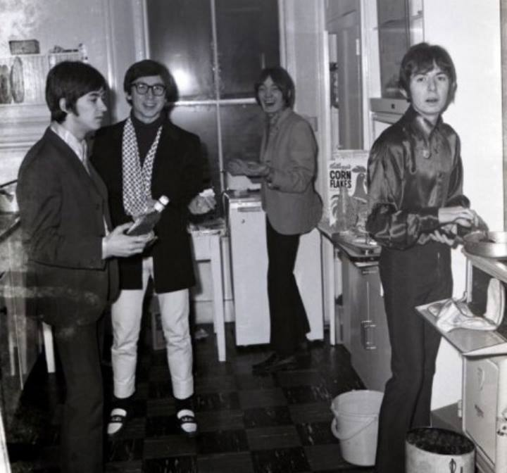 Small Faces, group portrait in kitchen
