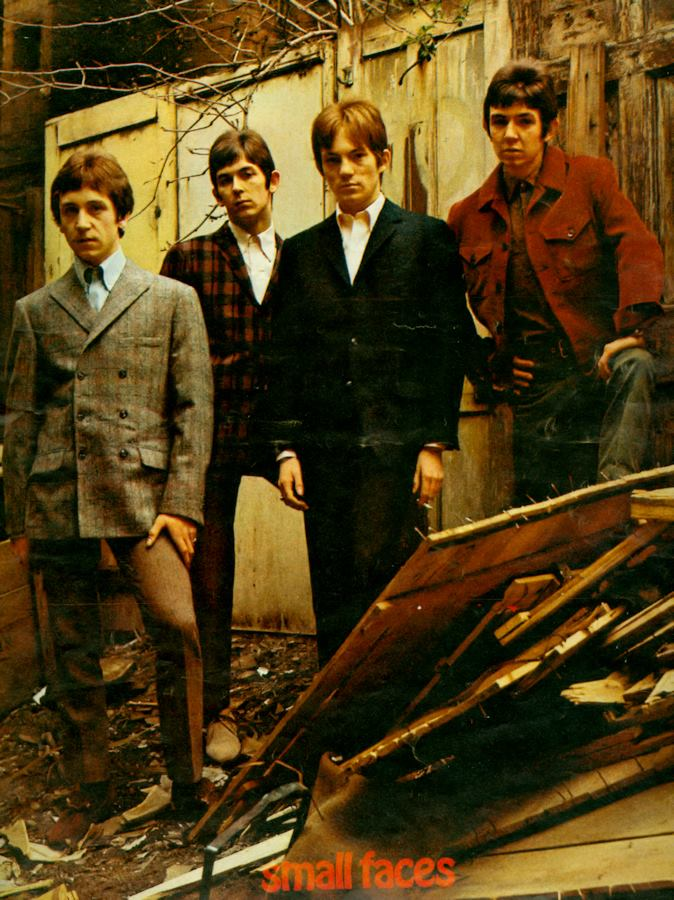 Small Faces group portrait in derelict building