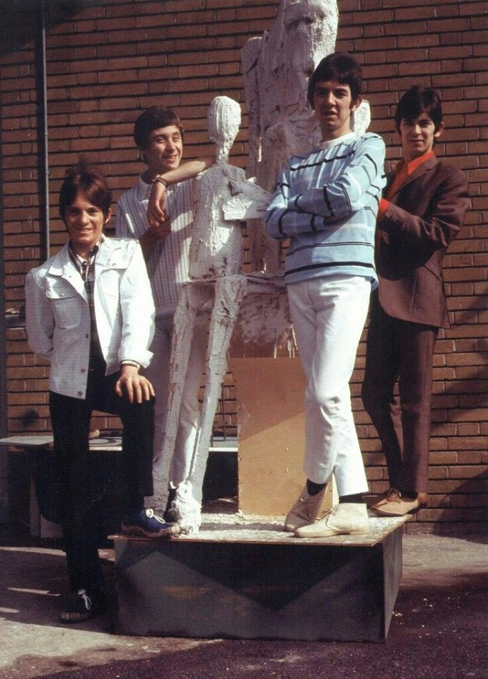 Small Faces group portrait with sculpture