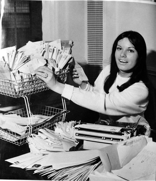Pauline answering mail